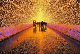 People walking through lighted tunnel.